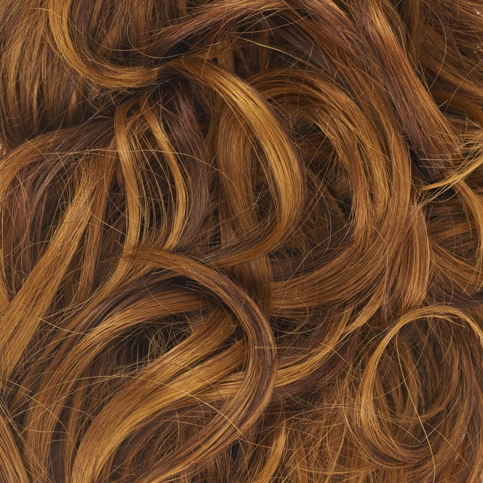 Curly hair fragment as a texture background composition
